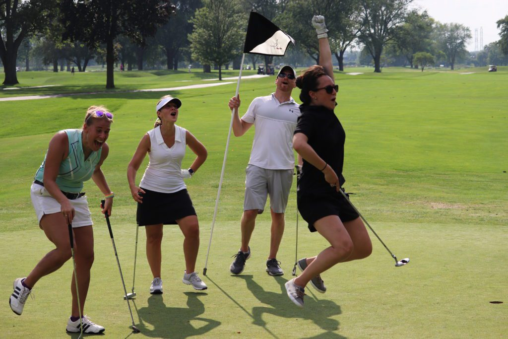 (L-R) Maggie Sketch, IBJI Senior Marketing Manager; Julie DiGiovanna, PT, Director of OrthoSync Clinical Services; and Mike Losch, IBJI Assistant Director or Rehab celebrate a long putt by Amy Illarde, IBJI Director of Communications and Employee Engagement.